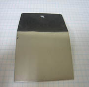 Fig. 16b Generic Semi-bright mid-phosphorus  Electroless Nickel Aluminum: 3003 H14 Bath Age: 3 MTO Plate Thickness: One mil Failed Bend and Tape Test (Left Edge)